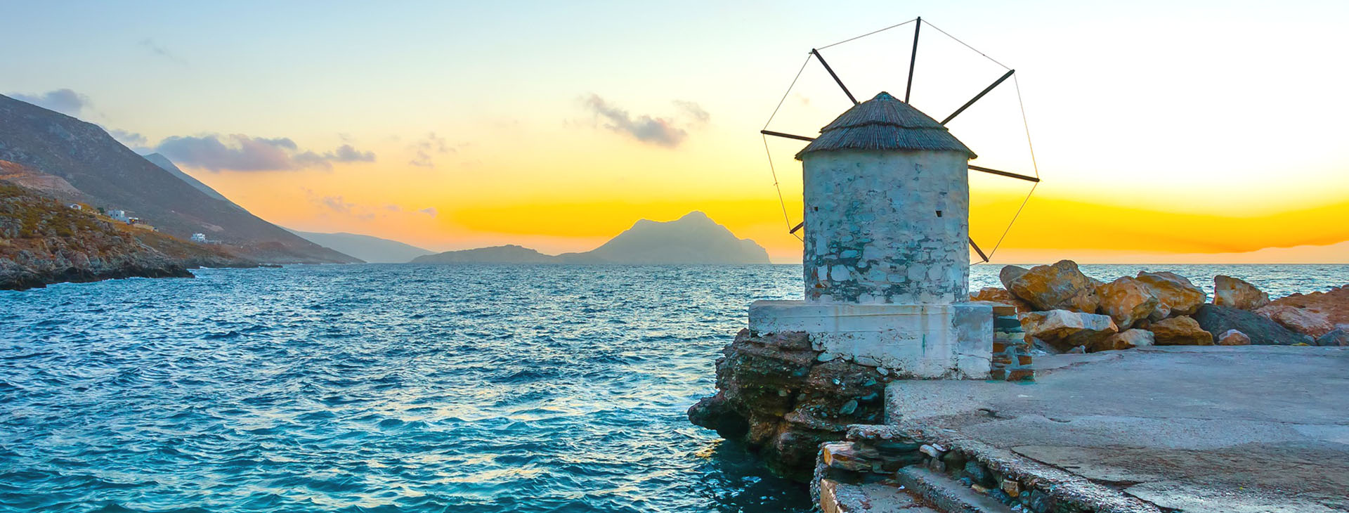Traditional windmill by the port of Aigiali village, Amorgos island