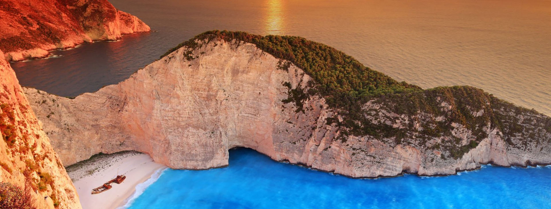 Sunset over Smugglers Cove on Zakynthos island