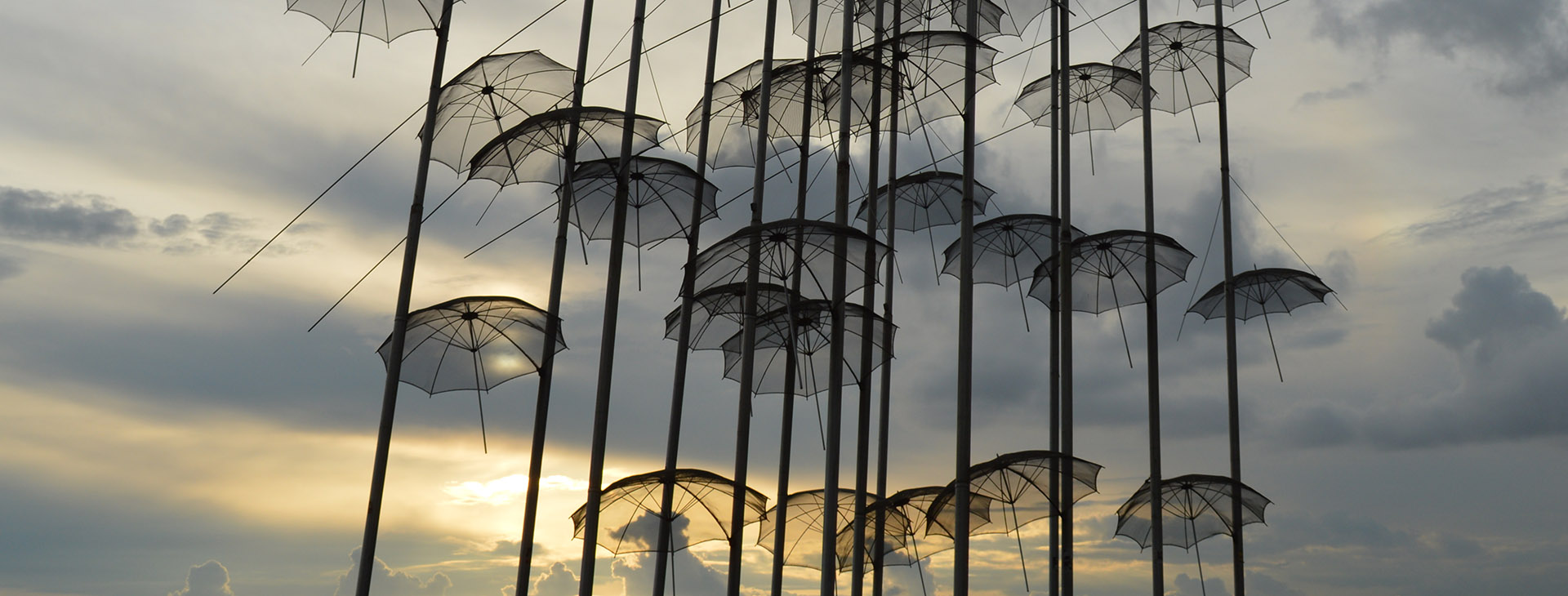 """Umbrellas"" modern art statue during sunset at the seafront of Thessaloniki City"