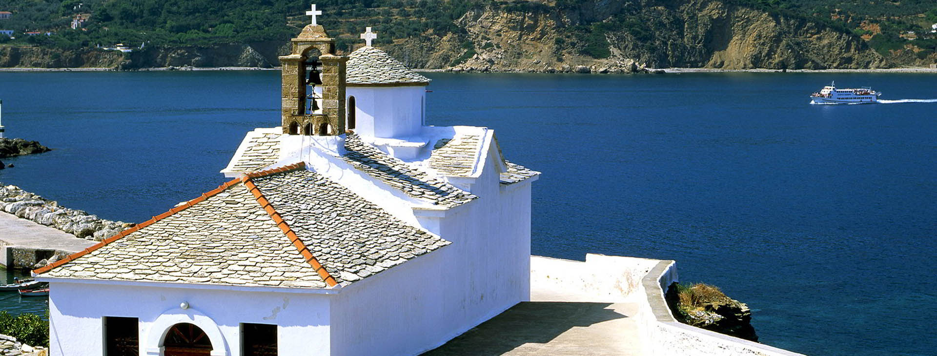Church overlooking Skopelos bay